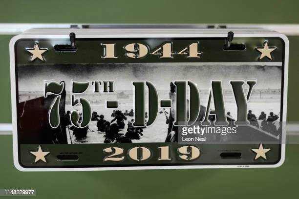 Commemorative DDay 75th anniversary vehicle registration plates are seen in the gift shop of the Crisbecq Battery on May 06 2019 in Saint Marcouf...