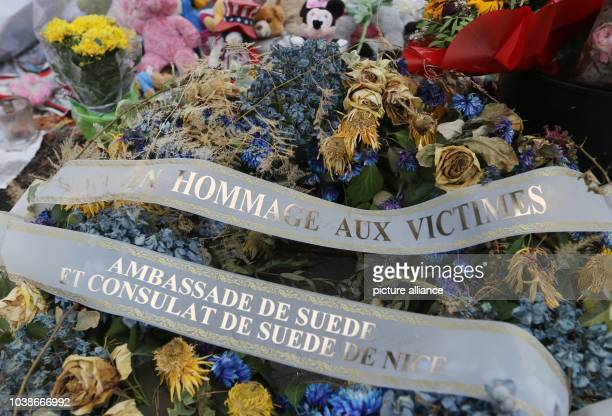 A commemorative flower wrath of the Swedish embassy lies on the 'Promenade des Anglais' in Nice France 14 September 2016 A 31yearold Tunisian man had...
