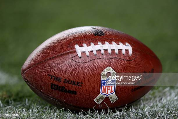 Commemorative football used in the game between the New England Patriots and the Denver Broncos at Sports Authority Field at Mile High on November...
