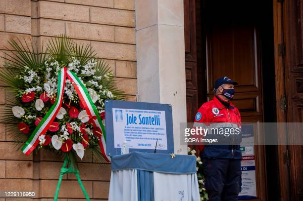 Commemorative notebook seen outside St. Nicholas Church during the funeral ceremony of the Calabria regional governor Jole Santelli. A funeral...