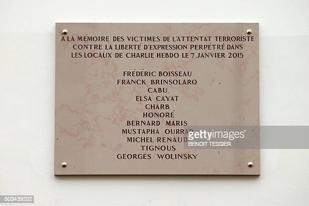 A commemorative plaque to pay tribute to the victims of the last year's January attacks is seen on January 5 2016 outside the former offices of...