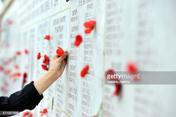 Commemorative poppies hang stuck by visitors next to names of some deceased Australian soldiers at the Lone Pine memorial near Eceabat during the...