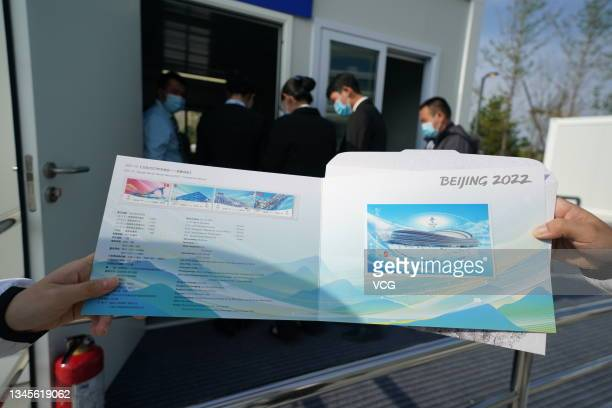 Commemorative stamps of 'Olympic Winter Games Beijing 2022 - Competition Venues' are pictured on day one of the Speed Skating China Open, a test...