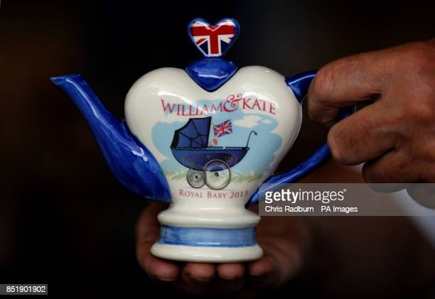 A commemorative teapot created to celebrate the birth of Prince George of Cambridge by Tony Carter Ceramic Designs in Debenham in Suffolk