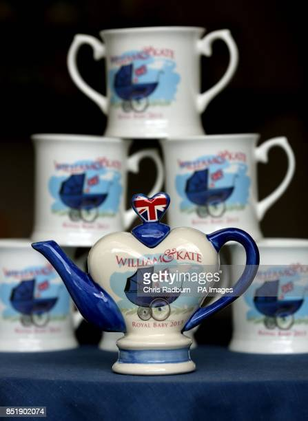 Commemorative teapots and mugs created to celebrate the birth of Prince George of Cambridge by Tony Carter Ceramic Designs in Debenham in Suffolk