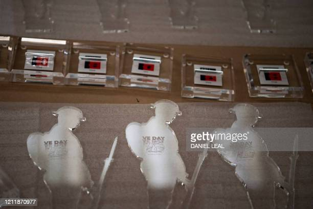 Commemorative Tommy figures await assembly ahead of shipping at the Royal British Legion Industries BBMC factory in Aylesford south east England on...