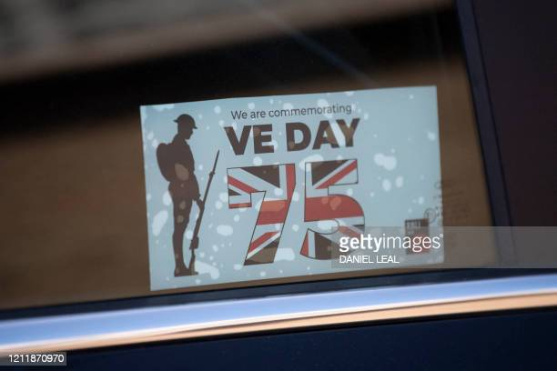 A commemorative VE Day window sticker is pictured in a car window outside the Royal British Legion Industries BBMC factory in Aylesford south east...