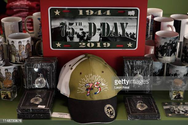Commemorative vehicle registration plates and caps are seen in the gift shop of the Crisbecq Battery on May 06 2019 in Saint Marcouf France With less...