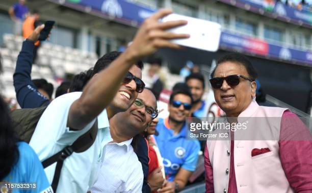 Commentator and ex player Sunil Gavaskar has his picture taken by fans during the Group Stage match of the ICC Cricket World Cup 2019 between India...