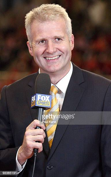 Commentator and former Australian basketball player Andrew Gaze presents on camera during the round eight NBL match between the Perth Wildcats and...