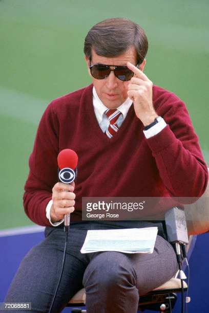Commentator Brent Musberger talks into a microphone during the 1985 NFC Divisional Playoffs game with the Dallas Cowboys against the Los Angeles Rams...