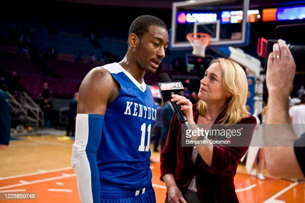 ESPN commentator Doris Burke interviews John Wall of the Kentucky Wildcats at Madison Square Garden on December 9 2009 in New York City
