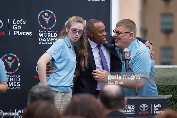 Commentator Jay Harris embraces Global Messangers Terra Clendening and Allen Wales at the Special Olympics World Games Los Angeles 2015 press...