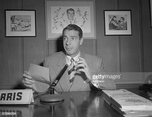 Commentator Joe DiMaggio makes a point during his television broadcast at Yankee Stadium. His relaxed, informative manner has won him more admirers...
