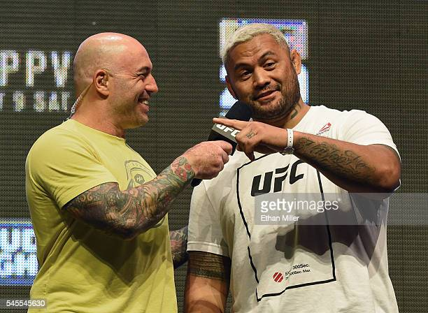 Commentator Joe Rogan interviews mixed martial artist Mark Hunt after his weighin for UFC 200 at TMobile Arena on July 8 2016 in Las Vegas Nevada...