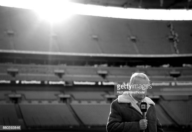 BBC Commentator John Motson looks on before the Premier League match between Tottenham Hotspur and West Bromwich Albion at Wembley Stadium on...