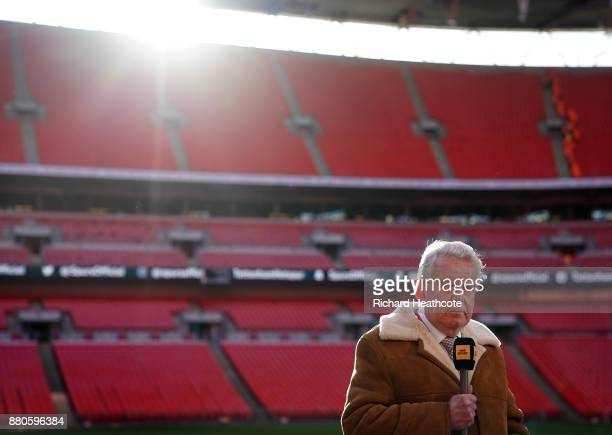 Commentator John Motson looks on before the Premier League match between Tottenham Hotspur and West Bromwich Albion at Wembley Stadium on November 25...