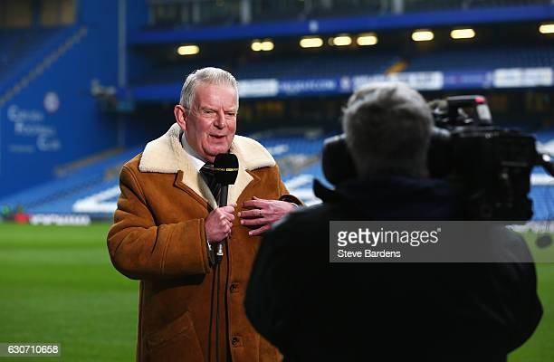 Commentator John Motson speaks prior to the Premier League match between Chelsea and Stoke City at Stamford Bridge on December 31 2016 in London...