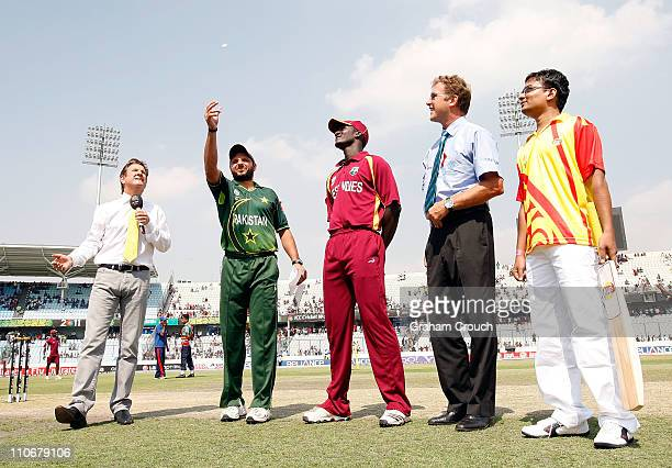 Commentator Mark Nicholas Shahid Afridi of Pakistan Darren Sammy of West Indies Match Referee Chris Broad and the Lays mascot attend the toss before...