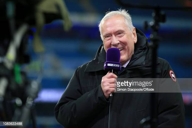Commentator Martin Tyler speaks into a beIN Sports microphone before the Premier League match between Manchester City and Wolverhampton Wanderers at...