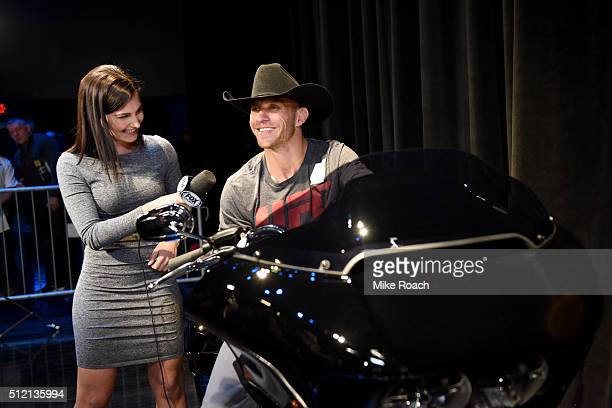 UFC commentator Megan Olivi interviews Donald Cerrone backstage as he is presented with a Harley Davidson motorcycle during the UFC Fight Night...