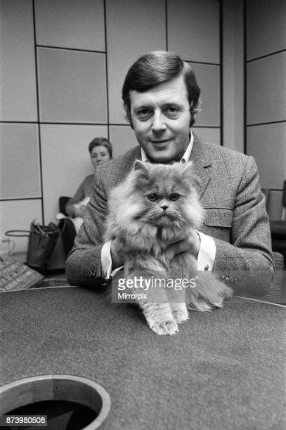 Commentator Michael Aspel at the BBC Studios at Lancaster Gate with a cat who is a contestant in the cat show this weekend, 27th November 1970.