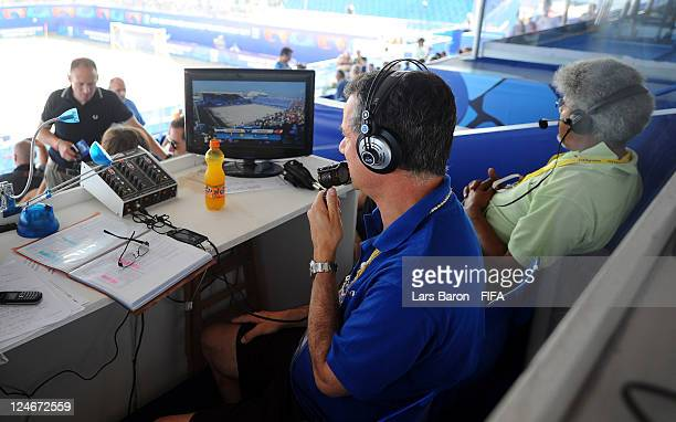 A commentator poses prior to the FIFA Beach Soccer World Cup 3rd Place Playoff match between El Salvador and Portugal at Stadium del Mare on...