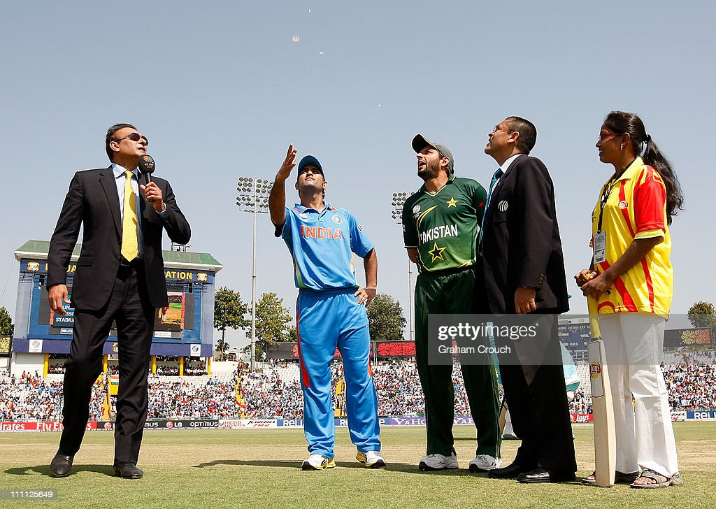 Commentator Ravi Shastri MS Dhoni of India Shahid Afridi of Pakistan match referee Ranjan Madugalle and Lays mascot Arancha at the toss during the...
