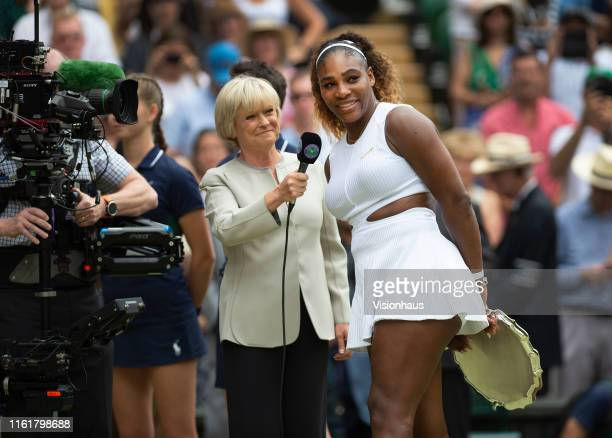 BBC commentator Sue Barker interviews Serena Williams of USA after her defeat to Simona Halep of Romania in the Final of the Ladies Singles on Day...