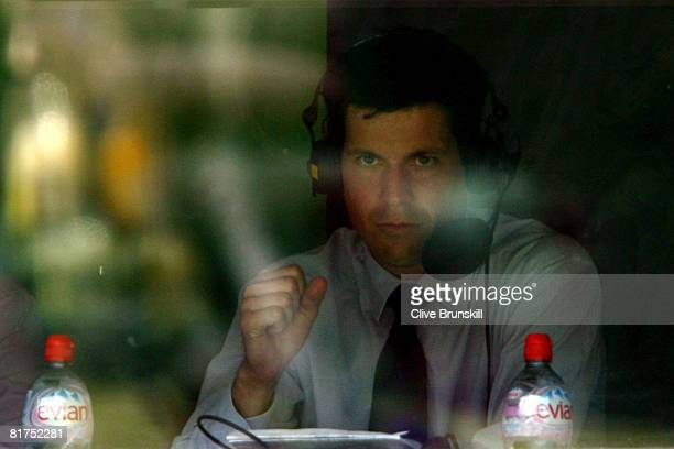 Commentator Tim Henman watches the Andy Murray of Great Britain and Tommy Haas of Germany men's singles round three match on day six of the Wimbledon...