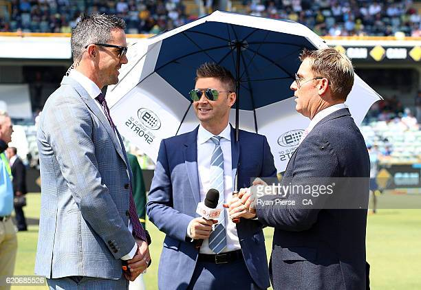 Commentators and former test cricketers Kevin Pietersen Michael Clarke and Shane Warne talk during day one of the First Test match between Australia...
