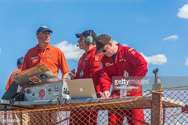 commentators and snowbirds coordinators - canadian snowbird stock pictures, royalty-free photos & images