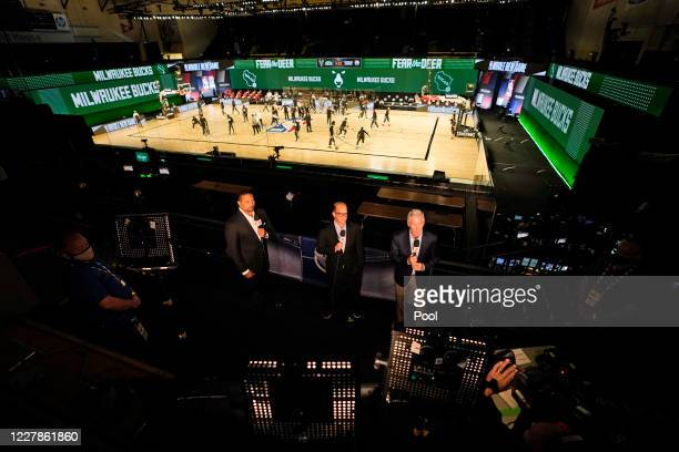 Commentators are seen in the stands as players warm up before the start of an NBA basketball game between the Milwaukee Bucks and the Boston Celtics...