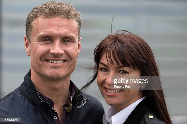 BBC commentators David Coulthard and Suzi Perry of Great Britain pose during the Australian Formula One Grand Prix at the Albert Park Circuit on...
