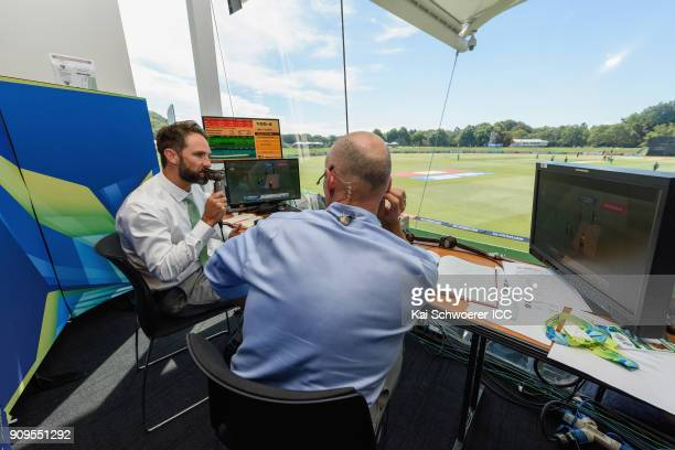 Commentators Grant Elliott and Danny Morrison look on during the ICC U19 Cricket World Cup match between Pakistan and South Africa at Hagley Oval on...