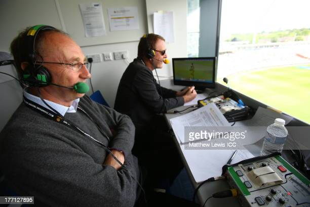 Commentators Jonathan Agnew Phil Tufnell watch the match while commentating during the ICC Champions Trophy Group A match between England and...