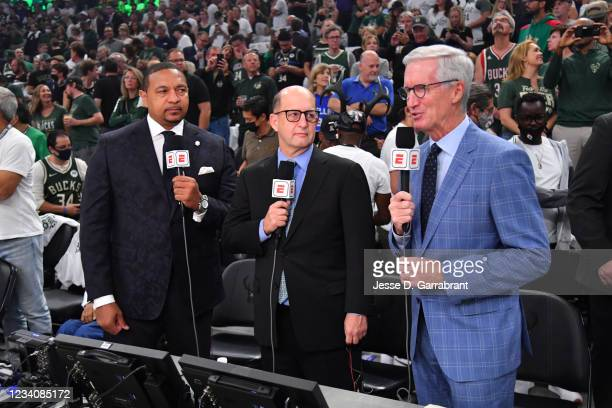 Commentators, Mark Jackson, Jeff Van Gundy, and Mike Breen look on before Game Six of the 2021 NBA Finals on July 20, 2021 at Fiserv Forum in...
