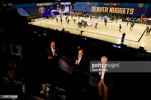 Commentators Mark Jackson, Jeff Van Gundy and Mike Breen talk prior to game between the Miami Heat and the Denver Nuggets at HP Field House at ESPN...