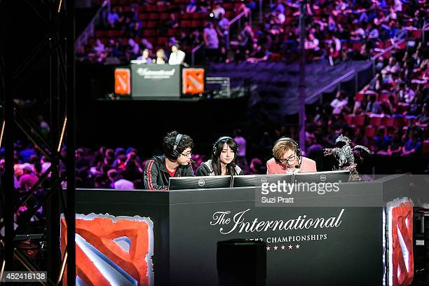 Commentators prepare for a live broadcast at The International DOTA 2 Championships at Key Arena on July 19 2014 in Seattle Washington