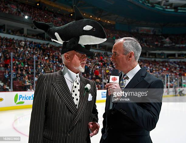 CBC commentators Ron MacLean and Don Cherry stand on the ice before the NHL game between the Vancouver Canucks and the Los Angeles Kings at Rogers...