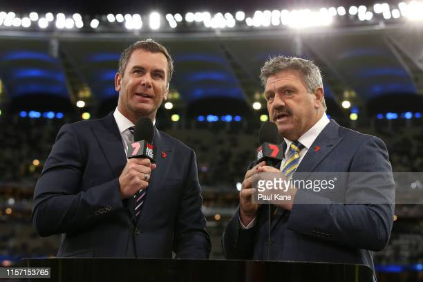 Commentators Wayne Carey and Brian Taylor talk to camera before the round 14 AFL match between the West Coast Eagles and the Essendon Bombers at...
