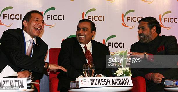 Commerce and Industry Minister Anand Sharma Mukesh Ambani Chairman and Managing Director of Reliance Industries and ViceChairman and Managing...