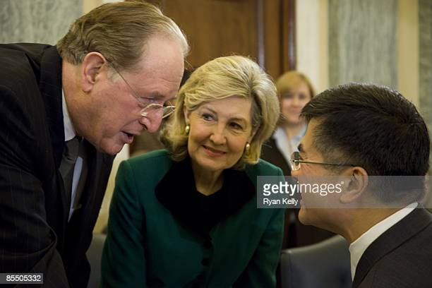 Commerce secretary designee Gary Locke talks to committee chairman Sen John D Rockefeller and ranking member Kay Bailey Hutchison before his...