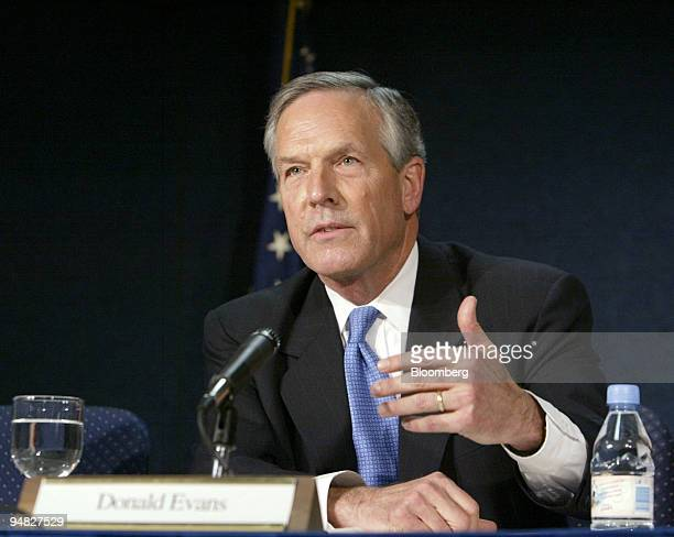 Commerce Secretary Donald Evans speaks at a news conference at the Department of Commerce in Washington DC on April 28 2004 Treasury Secretary John...