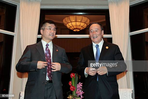 US Commerce Secretary Gary Locke and China's Vice Premier Wang Qishan pose at the start of their meeting in Hangzhou on October 28 2009 Ministers...