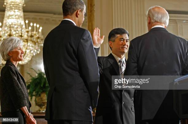S Commerce Secretary Gary Locke is sworn in by Vice President Joe Biden as President Barack Obama and Health and Human Services Secretary Kathleen...