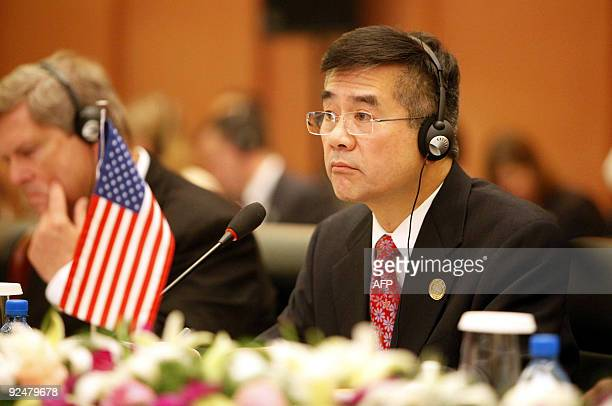US Commerce Secretary Gary Locke listens to a speech made by China's Vice Premier Wang Qishan during the opening ceremony of the 20th China and US...