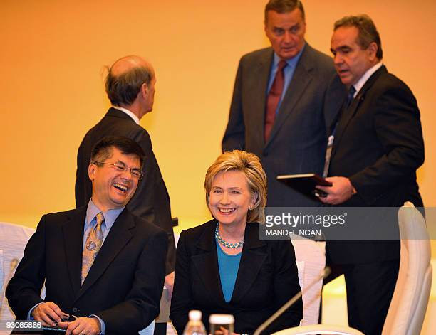 US Commerce Secretary Gary Locke shares a laugh with Secretary of State Hillary Clinton before the start of the ASEANUS leaders meeting at a hotel in...