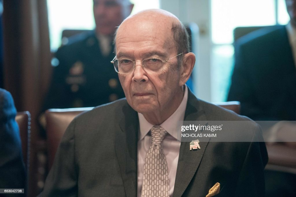 US Commerce Secretary Wilbur Ross listens as US President Donald Trump speaks to the press before he meeting with his Cabinet in the Cabinet Room of the White House in Washington, DC, on March 13, 2017. /