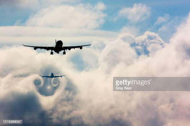 commercial aeroplanes queuing up to land - greg bajor stock pictures, royalty-free photos & images